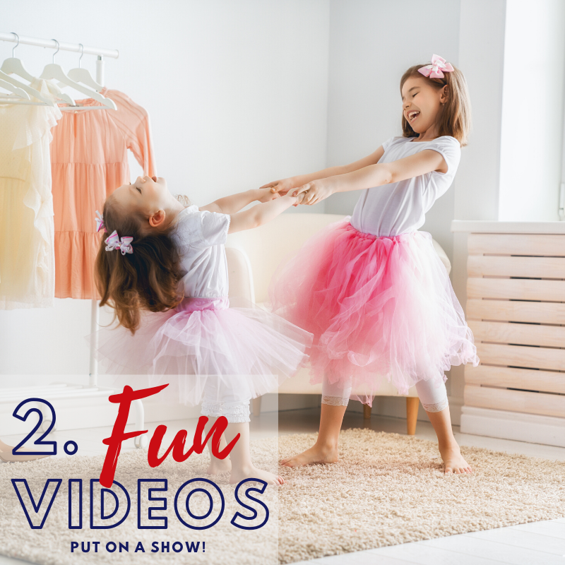Fun videos - Put on a show  Two young girls dressed in pink tutus spin one another around, laughing and playing.